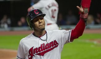Cleveland Indians' Francisco Lindor is greeted at the dugout after scoring on a fielders choice by Jose Ramirez during the first inning against the Baltimore Orioles of a baseball game in Cleveland, Sunday, Sept. 10, 2017. (AP Photo/Phil Long)