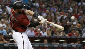 Arizona Diamondbacks' Paul Goldschmidt connects for a home run against the San Diego Padres during the fourth inning of a baseball game Sunday, Sept. 10, 2017, in Phoenix. (AP Photo/Ross D. Franklin)