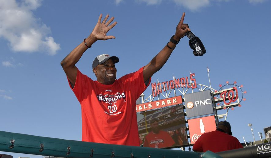 Washington Nationals manager Dusty Baker waves to the crowd in the stands as they celebrate after clinching the National League East title after a baseball game against the Philadelphia Phillies, Sunday, Sept. 10, 2017, in Washington.(AP Photo/Nick Wass)