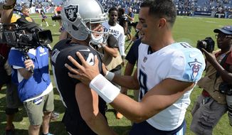 Oakland Raiders quarterback Derek Carr (4) and Tennessee Titans quarterback Marcus Mariota (8) talk after an NFL football game Sunday, Sept. 10, 2017, in Nashville, Tenn. The Raiders won 26-16.(AP Photo/Mark Zaleski)