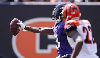 Baltimore Ravens wide receiver Jeremy Maclin (18) runs in a touchdown against Cincinnati Bengals cornerback William Jackson (22) in the first half of an NFL football game, Sunday, Sept. 10, 2017, in Cincinnati. (AP Photo/Gary Landers)