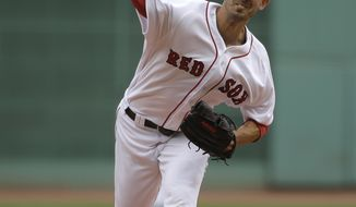 Boston Red Sox's Rick Porcello delivers a pitch against the Tampa Bay Rays in the first inning of a baseball game, Sunday, Sept. 10, 2017, in Boston. (AP Photo/Steven Senne)
