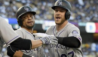 Colorado Rockies' Trevor Story, right, is congratulated by Gerardo Parra, left, after hitting a two-run home run, also scoring Parra, during the second inning of a baseball game against the Los Angeles Dodgers, Saturday, Sept. 9, 2017, in Los Angeles. (AP Photo/Michael Owen Baker)