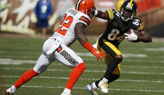 Pittsburgh Steelers wide receiver Antonio Brown (84) holds off Cleveland Browns linebacker Jabrill Peppers (22) during the second half of an NFL football game, Sunday, Sept. 10, 2017, in Cleveland. (AP Photo/Ron Schwane)