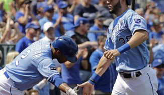 Kansas City Royals' Eric Hosmer (35) celebrates with Alcides Escobar (2) after Hosmer scored on a double by Brandon Moss during the second inning of a baseball game against the Minnesota Twins, Sunday, Sept. 10, 2017, in Kansas City, Mo. (AP Photo/Charlie Riedel)