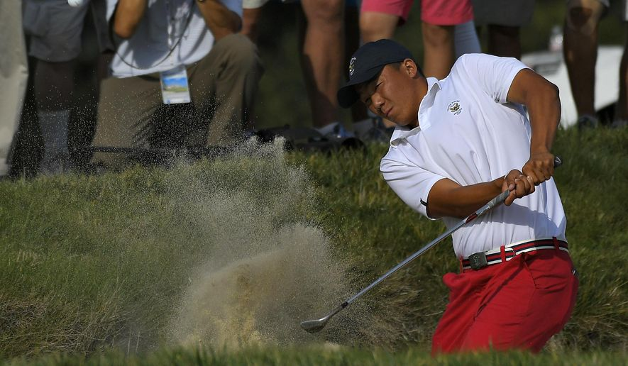 Norman Xiong, of the United States, hits out of a bunker on the 18th hole during singles at the Walker Cup golf matches at Los Angeles Country Club, Sunday, Sept. 10, 2017, in Los Angeles. (AP Photo/Mark J. Terrill)