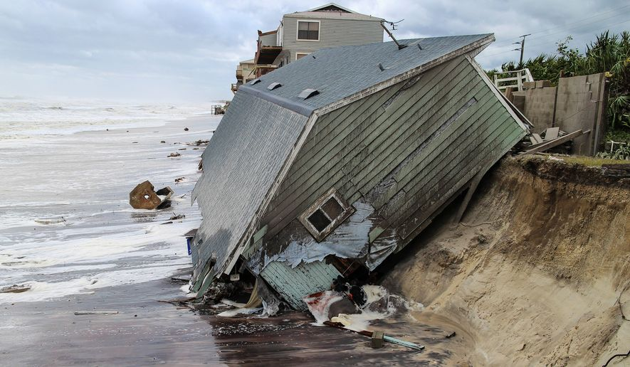 A house in Florida, slid into the Atlantic Ocean on Monday while Irma, downgraded to a tropical storm, was menacing Georgia and canceling flights at the world's busiest airport in Atlanta. (Gary Lloyd McCullough/The Florida Times-Union via AP)