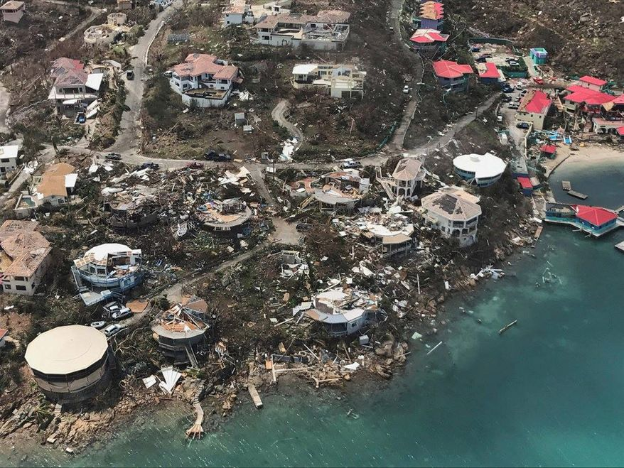 Hurricane Irma increased its death toll as it plowed its way through Florida after causing widespread destruction in the Caribbean, including here on the U.S. Virgin Islands. (Associated Press)