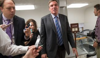 "Senate Intelligence Committee Vice Chairman Sen. Mark Warner, Virginia Democrat, suggested that ""pop up"" style online ads could be used to identify whether a political ad on social media was paid for by a foreign source. This is meant to help prevent foreign manipulation of political elections in the U.S. (Associated Press photographs)"