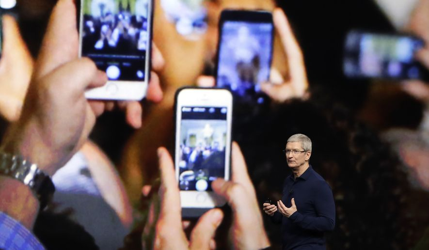 In this Wednesday, Sept. 7, 2016, file photo, Apple CEO Tim Cook announces the new iPhone 7 during an event to announce new products, in San Francisco. Apple is expected to demand $1,000 for the fanciest iPhone that it has ever made, thrusting the market into a new financial frontier that will test how much consumers are willing to pay for a device that has become an indispensable part of modern life. (AP Photo/Marcio Jose Sanchez, File)