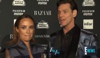 "Jim Carrey left an E! News reporter scratching her head after giving a bizarre, existential rant on the red carpet at Harper's Bazaar's ""Icons"" party in New York City Friday night. (E! News)"