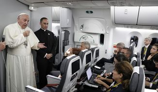 Pope Francis talks to journalists during a press conference he held on board the flight to Rome, at the end of a five-day visit to Colombia, Monday, Sept. 11, 2017. (AP Photo/Andrew Medichini, pool)