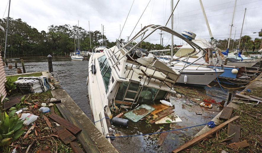 A Sinking Boat Is Surrounded By Debris In The Aftermath Of