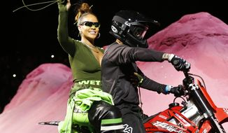 Rihanna rides on a motorcycle after showing her fashion collection from Fenty Puma by Rihanna during Fashion Week, Sunday, Sept. 10, 2017, in New York. (AP Photo/Bebeto Matthews)