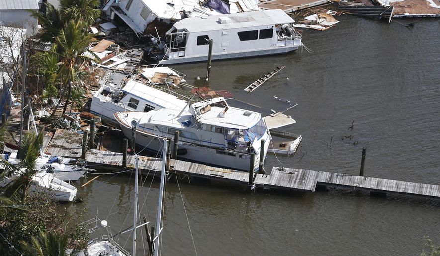 Boats and buildings are damaged in the aftermath of Hurricane Irma, Monday, Sept. 11, 2017, in Key Largo, Fla. (AP Photo/Wilfredo Lee)