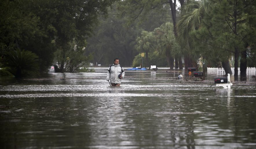 Joey Spalding walks back to his truck down the street where he lives, Monday, Sept. 11, 2017, on Tybee Island, Ga. Spalding just finished repairing his house from nine inches of water after Hurricane Matthew past the island last year. He said the Tropical Storm Irma brought three feet of storm surge into his living room today. (AP Photo/Stephen B. Morton)