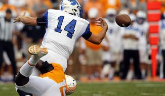 Indiana State quarterback Isaac Harker (14) fumbles the ball as he's hit by Tennessee defensive lineman Darrell Taylor (19) in the second half of an NCAA college football game, Saturday, Sept. 9, 2017, in Knoxville, Tenn. Tennessee won 42-7. (AP Photo/Wade Payne)