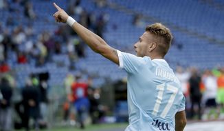 Lazio's Ciro Immobile celebrates after scoring during a Serie A soccer match between Lazio and AC Milan, at the Rome Olympic stadium, Sunday, Sept. 10, 2017. (AP Photo/Alessandra Tarantino)