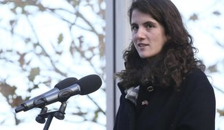FILE - In this Nov. 22, 2013, file photo, Tatiana Schlossberg granddaughter of President John F. Kennedy makes a short speech during a ceremony at the JFK memorial at Runnymede, England. The New York Times reported that Schlossberg married George Moran on Sept. 9, 2017, in Massachusetts. (AP Photo/Alastair Grant, File)