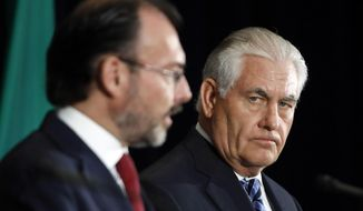 FILE - In this May 18, 2017 file photo, U.S. Secretary of State Rex Tillerson, right, listens as Mexican Foreign Secretary Luis Videgaray speaks at the State Department in Washington. Mexico's top diplomat will make a two-day visit to immigrant-friendly California as relations between his country and the U.S. government have strained over President Donald Trump's border wall and immigration and trade proposals. Videgaray is expected to meet with Gov. Jerry Brown and state legislative leaders in California's capital Monday, Sept. 11, 2017, before heading to Los Angeles Tuesday. (AP Photo/Jacquelyn Martin, File)