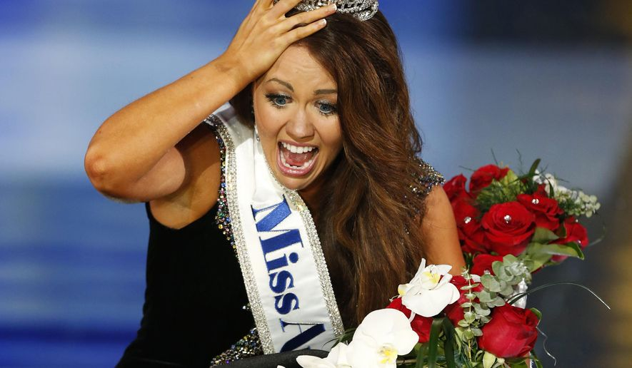 Miss North Dakota Cara Mund reacts after being named Miss America during Miss America 2018 pageant, Sunday, Sept. 10, 2017, in Atlantic City, N.J. (AP Photo/Noah K. Murray)