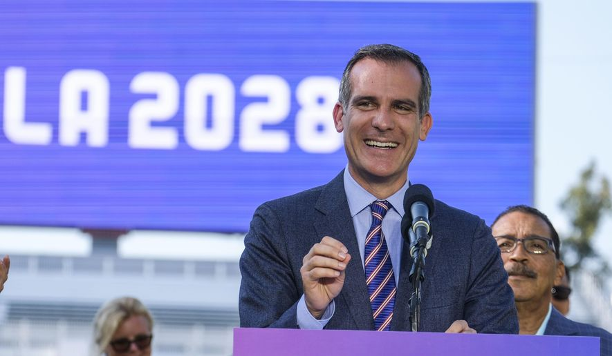 FILE - In this July 31, 2017, file photo, Los Angeles Mayor Eric Garcetti speaks during a press conference to make an announcement for the city to host the Olympic Games and Paralympic Games 2028, at Stubhub Center in Carson, outside of Los Angeles, Calif. After a debacle in Boston, the U.S. Olympic Committee turned to Los Angeles to host the Olympics. That city commissioned a poll showing 88 percent of its residents supported bringing the Olympics back to Southern California. That overarching public support has been a cornerstone of the city's bid, even though there are questions about whether anyone in Los Angeles is all that excited about an event that is still 11 years away. (AP Photo/Ringo H.W. Chiu, File) **FILE**