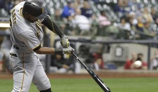 Pittsburgh Pirates' Starling Marte hits a two-run home run during the fifth inning of a baseball game against the Milwaukee Brewers Monday, Sept. 11, 2017, in Milwaukee. (AP Photo/Morry Gash)