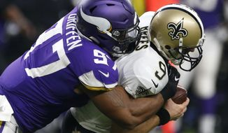 New Orleans Saints quarterback Drew Brees (9) is sacked by Minnesota Vikings defensive end Everson Griffen (97) during the first half of an NFL football game, Monday, Sept. 11, 2017, in Minneapolis. (AP Photo/Jim Mone)