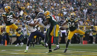 Green Bay Packers' Quinten Rollins (24) breaks up a pass intended for Seattle Seahawks' Jimmy Graham during the first half of an NFL football game Sunday, Sept. 10, 2017, in Green Bay, Wis. (AP Photo/Jeffrey Phelps)