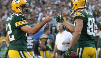 Green Bay Packers' Aaron Rodgers gives Jordy Nelson (87) a thumbs up after a touchdown catch during the second half of an NFL football game against the Seattle Seahawks Sunday, Sept. 10, 2017, in Green Bay, Wis. (AP Photo/Mike Roemer)