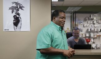 In this Sept. 8, 2017, photo, Frank Hawkins speaks with employees at the Nevada Wellness Center marijuana dispensary in Las Vegas. The former running back for the Raiders has two things that set him apart from most football players, a Super Bowl ring and a thriving pot shop just off the glittering Las Vegas Strip. (AP Photo/John Locher)
