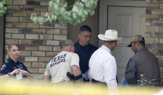 Plano police and the Texas Rangers work the scene of a shooting at a home in the 1700 block of West Spring Creek Parkway in Plano, Texas, Monday, Sept. 11, 2017. Multiple people were fatally shot to death, and their attacker was killed by a police officer Sunday night, authorities said. (David Woo/The Dallas Morning News via AP)