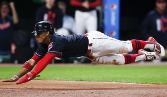 Cleveland Indians' Francisco Lindor scores on a sacrifice fly by Jose Ramirez against the Detroit Tigers during the second inning in a baseball game, Monday, Sept. 11, 2017, in Cleveland. (AP Photo/Ron Schwane)
