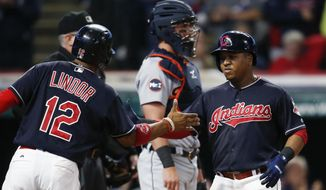 Cleveland Indians' Jose Ramirez gets congratulations from Francisco Lindor (12) after hitting a two run home run off Detroit Tigers starting pitcher Myles Jaye as catcher James McCann stands in the background during the fourth inning in a baseball game, Monday, Sept. 11, 2017, in Cleveland. (AP Photo/Ron Schwane)