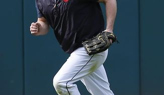 Cleveland Indians' Jason Kipnis works in the outfield before a baseball game against the Detroit Tigers, Monday, Sept. 11, 2017, in Cleveland. The Indians will be testing Kipnis in the outfield after the injury to Bradley Zimmer. (AP Photo/Ron Schwane)
