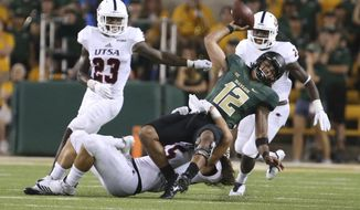 Baylor quarterback Anu Solomon (12) is pulled down by UTSA linebacker Josiah Tauaefa (55) on fourth down during Baylor's final possession in an NCAA college football game, Saturday, Sept. 9, 2017, in Waco, Texas. UTSA won 17-10. (Rod Aydelotte/Waco Tribune Herald, via AP)