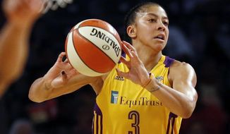 FILE - In this June 30, 2017 fie photo, the Los Angeles Sparks' Candace Parker passes the ball during a WNBA basketball game against the Atlanta Dream in McCamish Pavilion in Atlanta. The waiting is almost over for Parker and the defending WNBA champion Sparks. After being off for over a week, the Sparks finally know they'll be playing the Phoenix Mercury in the semifinals starting Tuesday, Sept. 12, 2017. (AP Photo/Andy Buhler, File)