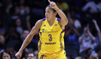 FILE - In this Aug. 4, 2017 file photo, the Los Angeles Sparks' Candace Parker celebrates her basket against the New York Liberty in a WNBA basketball game in Los Angeles. The waiting is almost over for Parker and the defending WNBA champion Sparks. After being off for over a week, the Sparks finally know they'll be playing the Phoenix Mercury in the semifinals starting Tuesday, Sept. 12, 2017. (AP Photo/Jae C. Hong, File)