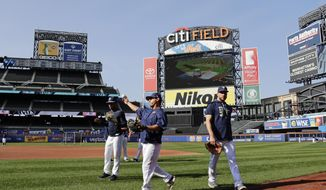 Tampa Bay Rays players warm up at Citi Field before a baseball game against the New York Yankees Monday, Sept. 11, 2017, in New York. The Yankees will be the visiting team for the series moved from St. Petersburg, Florida, because of Hurricane Irma. (AP Photo/Frank Franklin II)