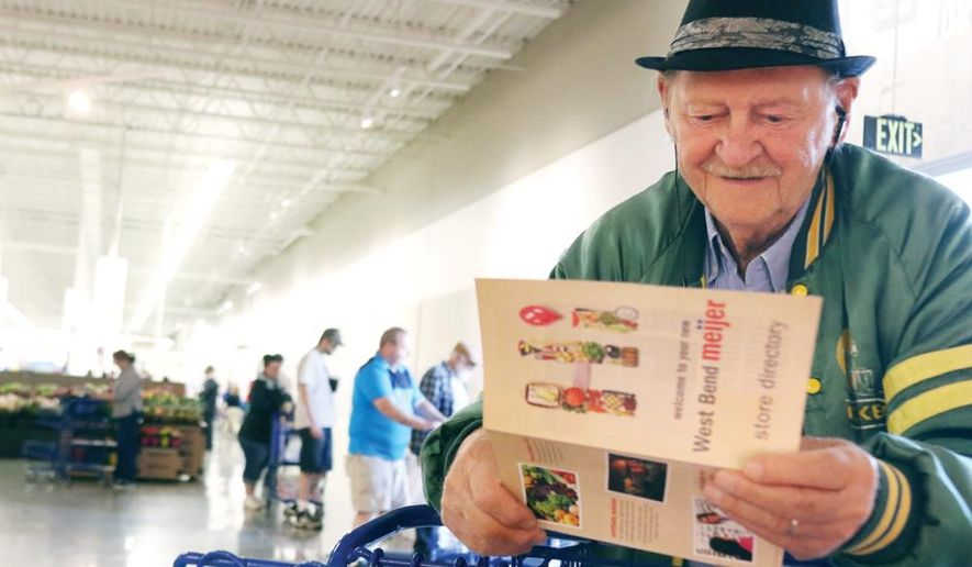 ADVANCE FOR THE WEEKEND OF SEPT. 16-17 AND THEREAFTER - In this May 16, 2017, photo, Stephen Potandy of West Bend smiles as he looks over the store directory during the grand opening ceremony for Meijer in West Bend, Wis. (John Ehlke/West Bend Daily News via AP)
