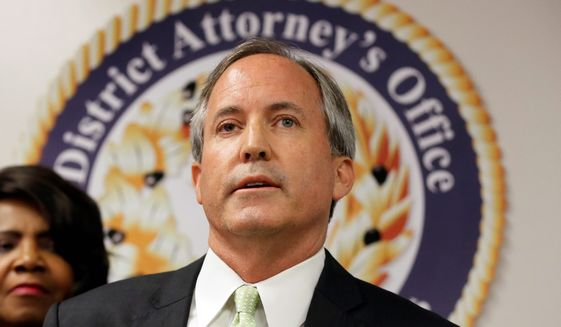 Texas Attorney General Ken Paxton speaks at a news conference in Dallas on June 22, 2017. (Associated Press) ** FILE **