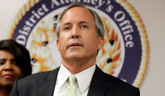 Texas Attorney General Ken Paxton speaks at a news conference in Dallas on June 22, 2017. (Associated Press) **FILE**