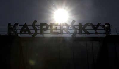 A sign above the headquarters of Kaspersky Lab in Moscow, Russia, Saturday, July 1, 2017. The chief executive of Russia's Kaspersky Lab, Eugene Kaspersky, says he's ready to have his company's source code examined by U.S. government officials to help dispel long-lingering suspicions about his company's ties to the Kremlin.(AP Photo/Pavel Golovkin)
