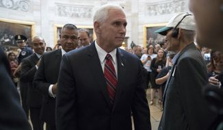 Vice President Mike Pence greets tourists at the Capitol in Washington as he arrives for a meeting with Senate Majority Leader Mitch McConnell, R-Ky, Treasury Secretary Steven Mnuchin, and President Donald Trump's top economic adviser Gary Cohn, to work on a tax code overhaul, Tuesday, Sept. 12, 2017. The as-yet-undrafted bill to overhaul the tax code is the top priority for Trump and Republicans after the collapse of their effort to dismantle Barack Obama's health care law. (AP Photo/J. Scott Applewhite)