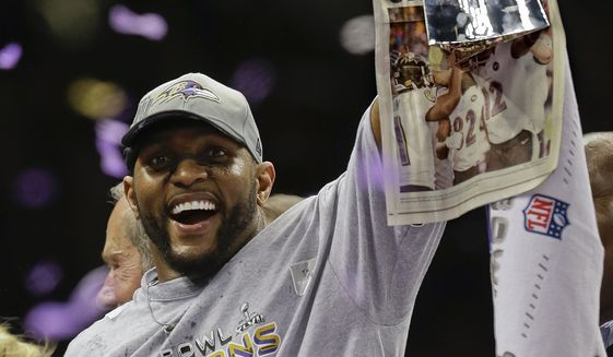 FILE - In this Sunday, Feb. 3, 2013 file photo, Baltimore Ravens linebacker Ray Lewis (52) holds up the Vince Lombardi Trophy after defeating the San Francisco 49ers 34-31 in the NFL Super Bowl XLVII football game in New Orleans. Star linebackers Ray Lewis and Brian Urlacher and game-breaking wide receiver Randy Moss are among 11 first-year eligible players for the Pro Football Hall of Fame.  (AP Photo/Julio Cortez, File) **FILE**