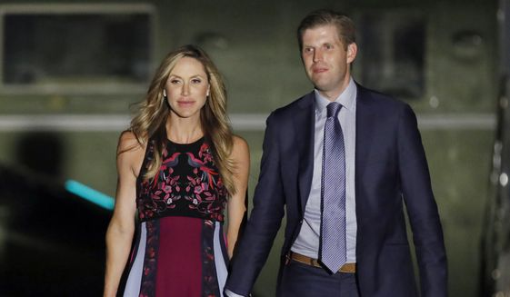 In this Aug, 3, 2017, file photo, Eric Trump, right, and his wife Lara Trump, walk away from Marine One on the South Lawn of the White House in Washington. (AP Photo/Alex Brandon) ** FILE **