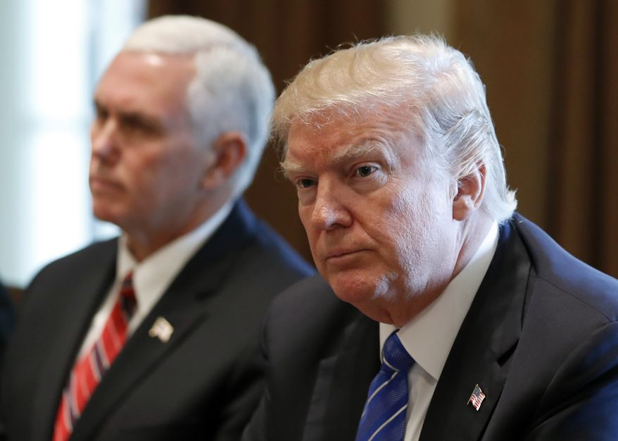 President Donald Trump, right, with Vice President Mike Pence, pauses while speaking during a meeting with Malaysian Prime Minister Najib Razak in the Cabinet Room of the White House, Tuesday, Sept. 12, 2017, in Washington. (AP Photo/Alex Brandon)