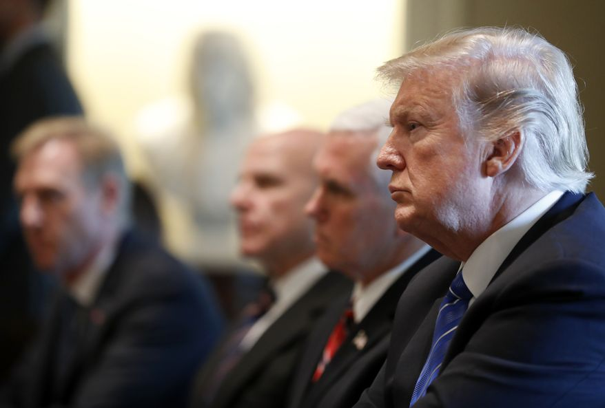 President Donald Trump, right, with Vice President Mike Pence, and others, listen during a meeting with Malaysian Prime Minister Najib Razak in the Cabinet Room of the White House, Tuesday, Sept. 12, 2017, in Washington. (AP Photo/Alex Brandon)
