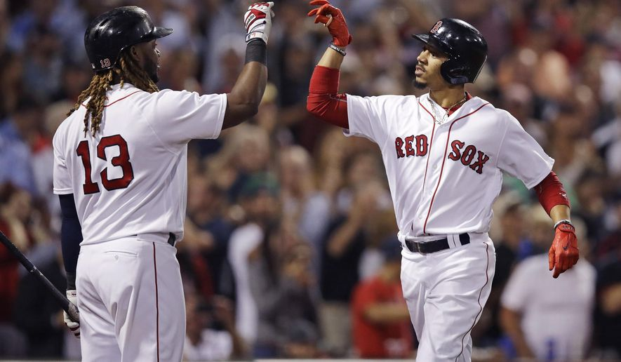 Boston Red Sox's Mookie Betts, right, is congratulated by Hanley Ramirez after his two run home run during the fourth inning of a baseball game against the Oakland Athletics at Fenway Park in Boston, Tuesday, Sept. 12, 2017. (AP Photo/Charles Krupa)