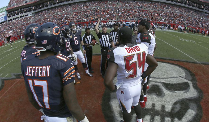 FILE - In this Nov. 13, 2016, file photo, the Chicago Bears and Tampa Bay Buccaneers take part in the coin toss before an NFL football game, in Tampa, Fla. There will be football in Tampa this weekend, and the Buccaneers will finally get to start a season delayed by Hurricane Irma's wrath. The Bucs announced that they will be able to host the Chicago Bears on Sunday, Sept. 17, 2017, at Raymond James Stadium. (AP Photo/Chris O'Meara, File)